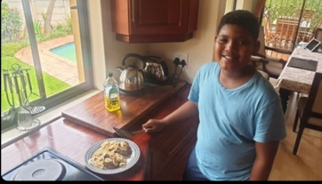 Langa making breakfast